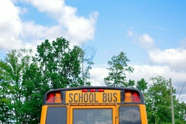 School Bus and blue sky with trees